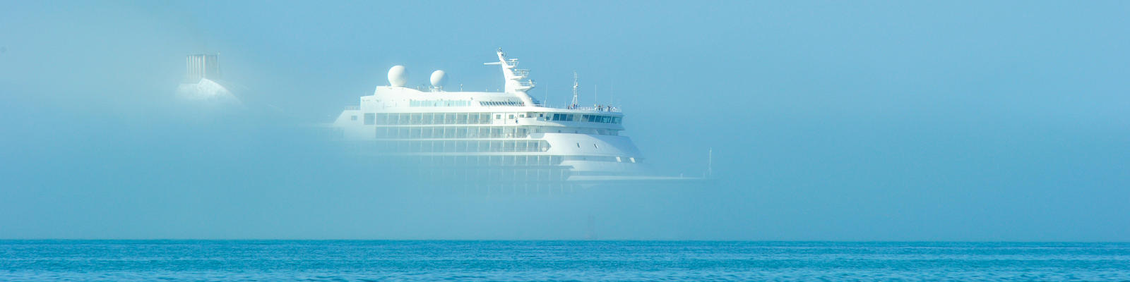 Cruise ship emerging from the fog in Key West. (Photo: HeliHead/Shutterstock)