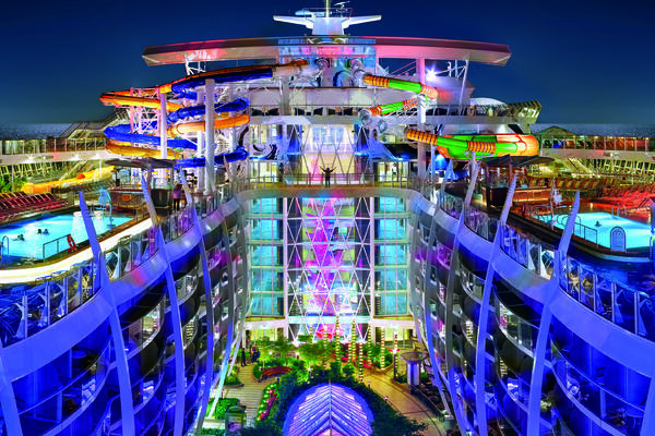 The top deck on Harmony of the Seas with a view of the pools, Perfect Storm waterslide and Central Park (Photo: Royal Caribbean)