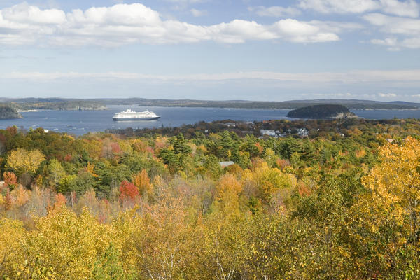 Cruise ship sailing past an autumn landscape (Photo: Joseph Sohm/Shutterstock)