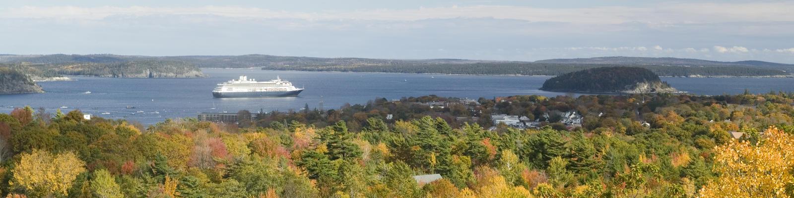 Cruise ship sailing past an autumn landscape (Photo: Joseph Sohm/Shutterstock)