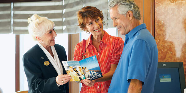 Couple talking to a travel agent (Photo: Princess Cruises)