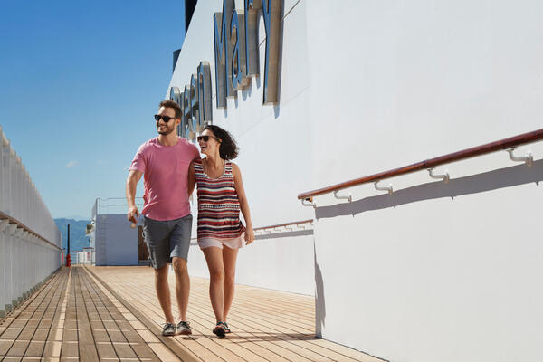 Couple on the sun deck on Queen Mary 2 (Photo: Cunard)