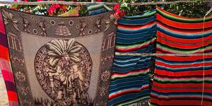 Blankets and throw rugs sold by local merchants in Cozumel, Mexico (Photo: Adam Coulter)