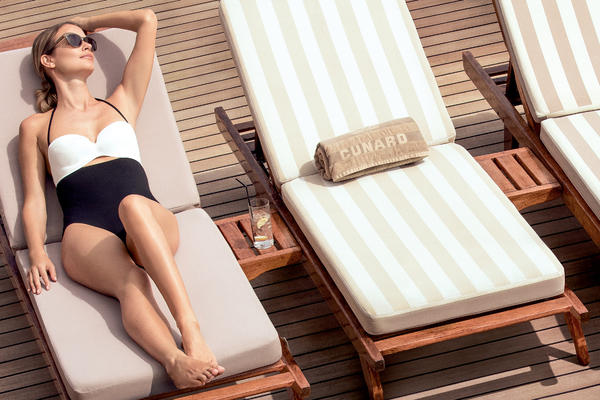 Lounging on the sun deck of Queen Mary 2 (Photo: Cunard Line)