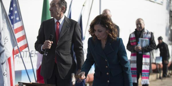 Madrina Francesca Giovagnoli, alongside Fincantieri's Shipyard Director Giovanni Stecconi, cuts cord to release Champagne bottle (Photo: Regent Seven Seas Cruises)