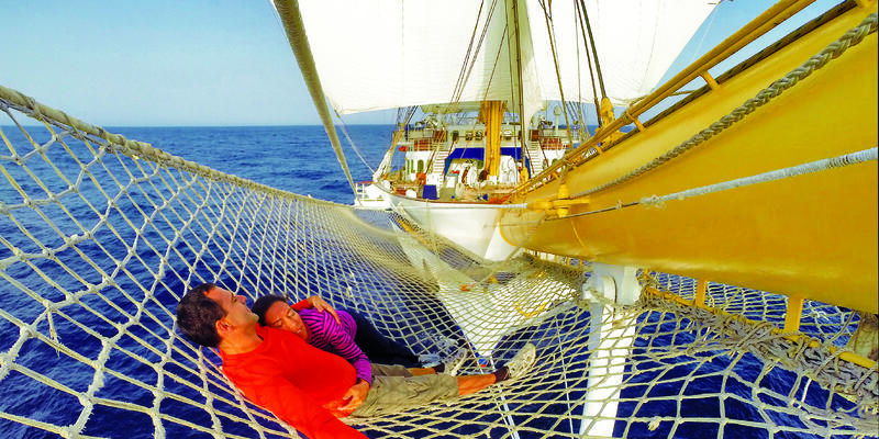 Couple lounging on Royal Clipper (Photo: Star Clippers)